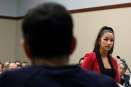 Victim and former gymnast Aly Raisman speaks at the sentencing hearing for Larry Nassar, (R) a former team USA Gymnastics doctor who pleaded guilty in November 2017 to sexual assault charges, in Lansing